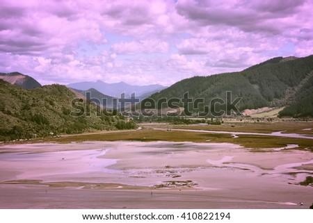 Mahau Sound - tidal mud flats in Marlborough region of New Zealand. Cross processed color tone - retro filtered style. - stock photo