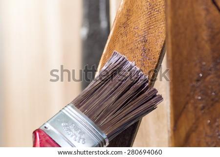 mahogany planks painting with a brush - stock photo