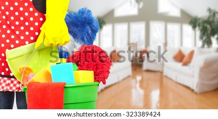 Maid hands with cleaning tools. House cleaning service concept. - stock photo