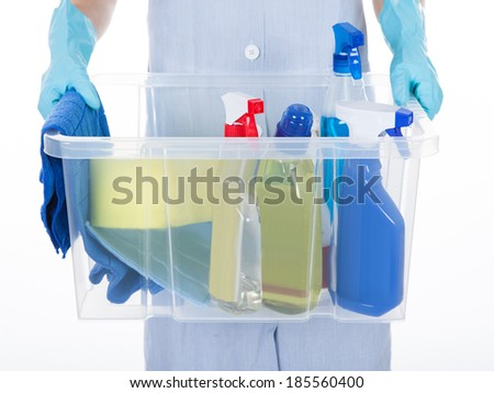 Maid Holding Bucket With Cleaning Supplies Over White Background - stock photo
