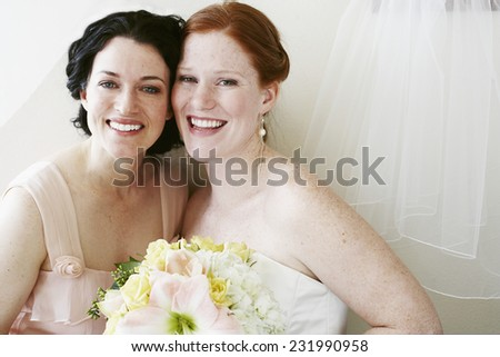 Maid of Honor and Bride - stock photo