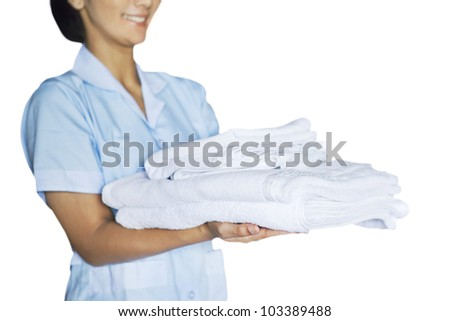 Maid woman holding towels. Shot at studio isolated on white background - stock photo