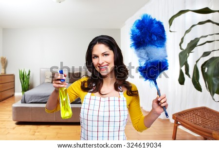 Maid woman with tools. House cleaning service concept. - stock photo
