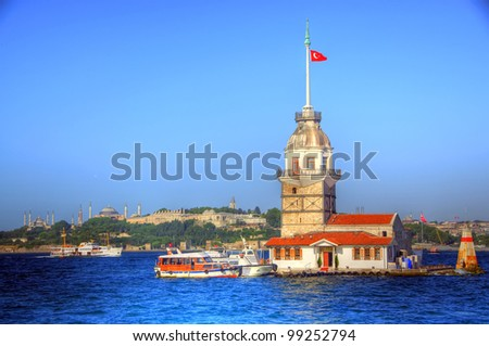 Maiden's Tower at Bosphorus Strait with Sultanahmet Region in the Background, Istanbul, Turkey - stock photo