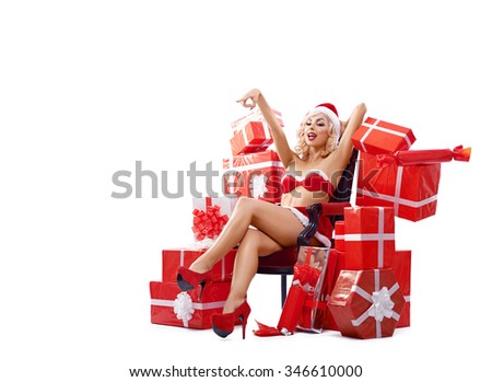 Maiden, snow woman, beautiful, sexy, attractive Snow Maiden in red suit sitting on a chair surrounded by gifts, points and smiles.