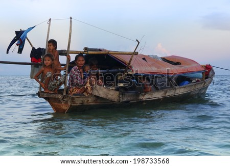 MAIGA ISLAND, MALAYSIA - JUNE 5 : Family of Sea Gypsy (Bajau Laut) living in the boat house June 5th, 2014 in Maiga Island, Sabah, Malaysia. The Bajau Laut are the sea gypsies who live in the open sea - stock photo