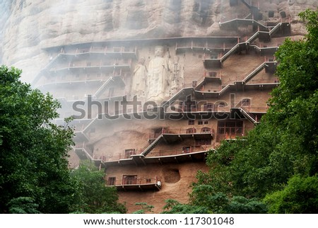 Maiji Caves in Gansu. Maijishan Grottoes. Located in Tianshui County, the Maiji Caves include 194 caves with more than 7,200 clay statues and stone carvings - stock photo