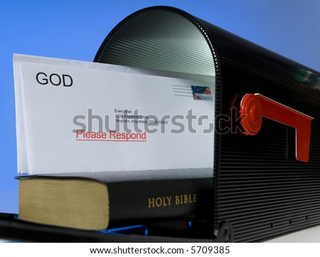 Mail box containing Holy Bible on white background, symbolizing that the Bible is a message or mail from God - stock photo