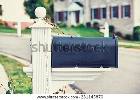Mail Box on a house background  - stock photo