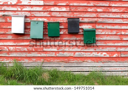 mail boxes on a wall - stock photo