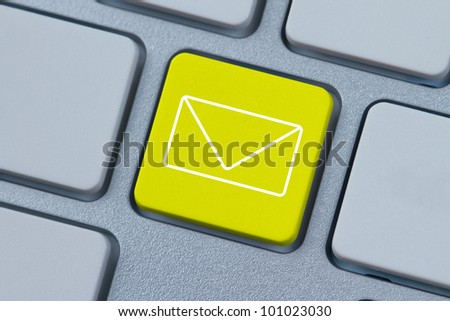 Mail icon at the computer key - stock photo