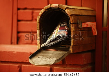 Mailbox and a Red Brick House