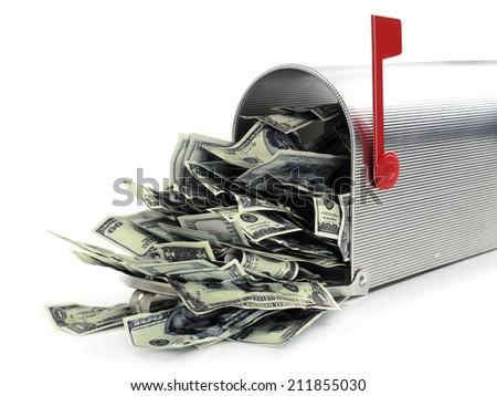 Mailbox full of money Mailbox full of dollars, white background - stock photo