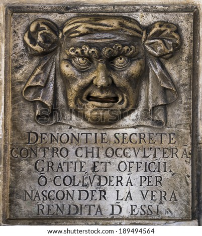 """Mailbox """"Mouth of Truth"""" located at the Palazzo Duca. Venice. Italy - stock photo"""