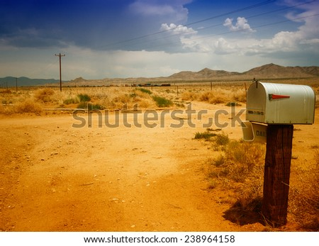 Mailbox on a countryside road. - stock photo