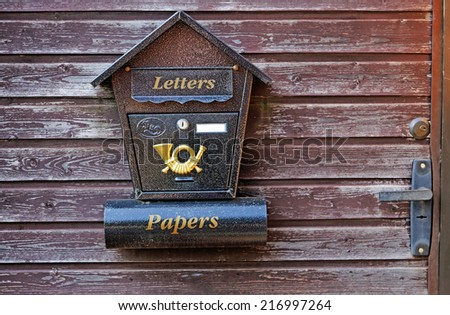 Mailbox on a wooden gate close-up  - stock photo