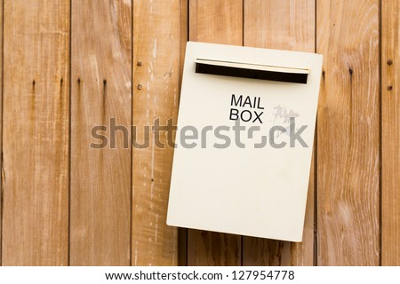 Mailbox on old wood wall - stock photo