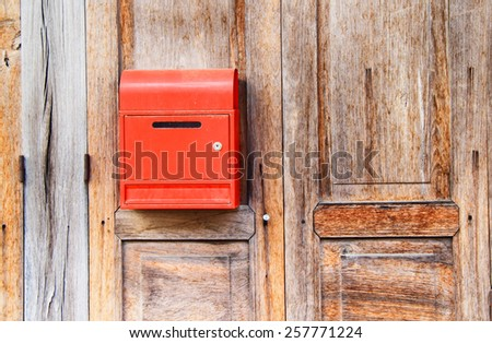 mailbox on wood background - stock photo