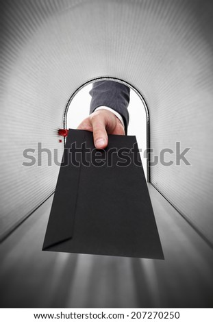 Mailman holding a black envelope - stock photo