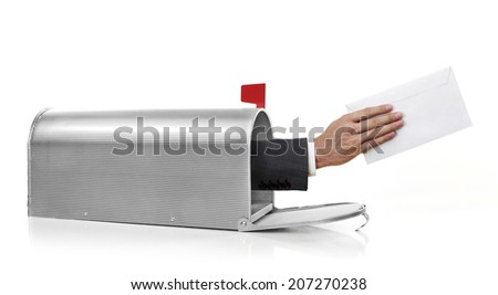 Mailman with envelope Mailman holding a white envelope - stock photo