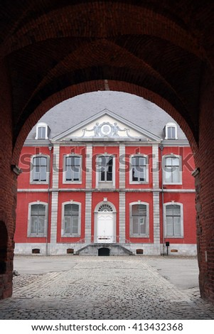 Main building of the Stavelot Abbey seen through a archway. The Abbey of the Prince-Bishops of Stavelot, Belgium. - stock photo