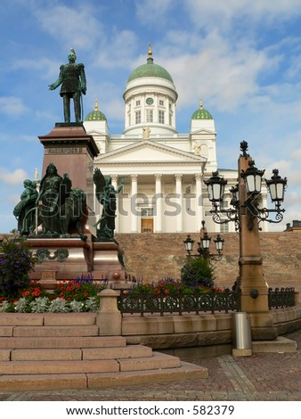 Main cathedral of Helsinki, Finland. On the left statue of Russian czar Alexander II. - stock photo