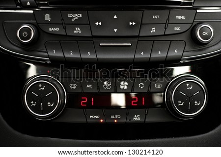 Main dashboard of an autovehicle, interior-central view - stock photo