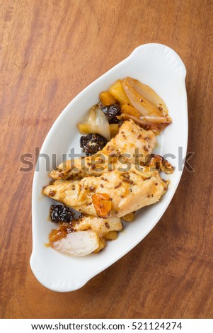 Main dish of chicken thighs, apricots, prunes and parsnip.