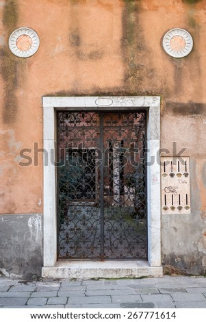 Main door of an old house in Venice, Italy - stock photo