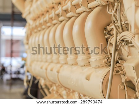 main engine of merchant ship in close up at the factory - stock photo