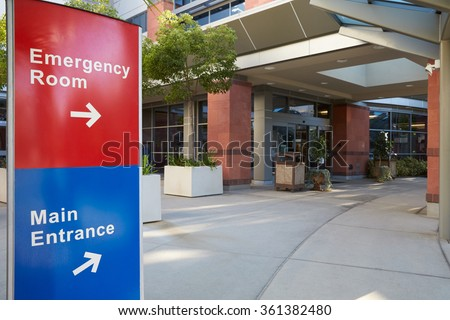 Main Entrance Of Modern Hospital Building With Signs - stock photo