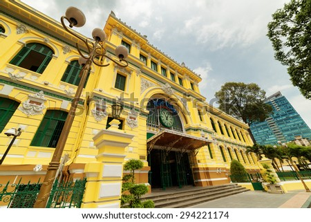 Main entrance of Saigon Central Post Office in Ho Chi Minh city, Vietnam. Steel structure of the gothic building was designed by Gustave Eiffel. Ho Chi Minh is a popular tourist destination of Asia. - stock photo