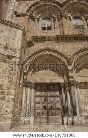 Main entrance to the Church of the Holy Sepulchre in old city of Jerusalem - stock photo