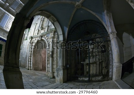Main entrance to the old medieval town Korcula  by night. Croatia, Europe. Fish eye lens shot. - stock photo