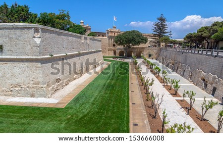 Main gate and wall of Mdina fortification in Malta. - stock photo