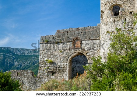 Main gate of abandoned old turkish fortress Haj-Nehaj on the mountain near Sutomore village, Montenegro.