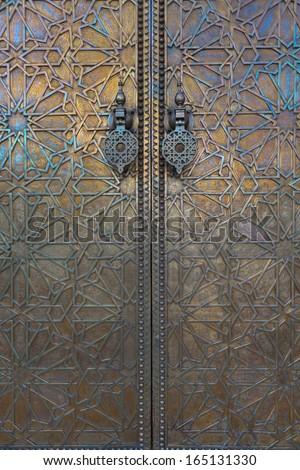 Main golden gates of royal palace in marrakesh, morocco - stock photo