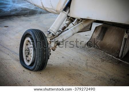Main landing gear waiting maintenance. - stock photo