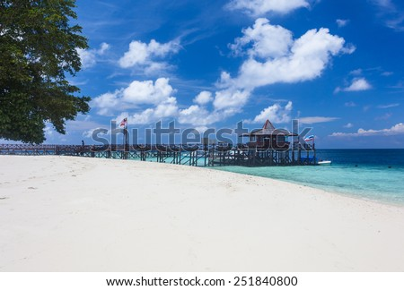 Main pier and white sand beach on Pulau Sipadan island near Borneo, Malaysia - stock photo