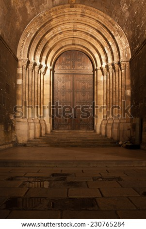 Main portal to the Lisbon Cathedral at night in Portugal. - stock photo