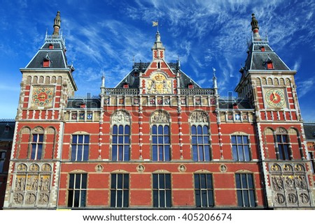 Main railway station in Amsterdam, Netherlands. /The railway station was designed by Dutch architect Pierre Cuypers and first opened in 1889. - stock photo