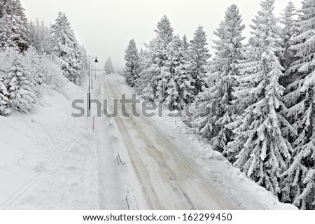 Main road after heavy snowfall - stock photo