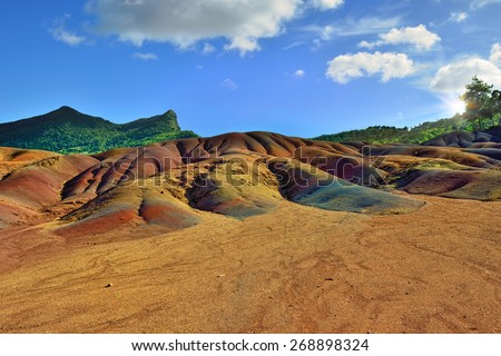 Main sight of Mauritius island. Unusual volcanic formation seven colored earths in Chamarel. - stock photo