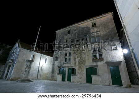Main square in old medieval town Korcula  by night. Croatia, Europe. - stock photo