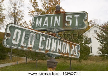 Main Street and Old Common Road sign in autumn, western Massachusetts, New England - stock photo