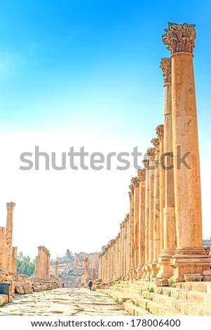 Main street of Gerasa in the ancient Jordanian city of Jerash, Jordan.   It is known as the Cardo maximus. It is located about 48 km north of Amman. - stock photo