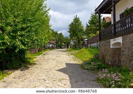 Main street of the Holloko village, Hungary. UNESCO World Heritage Site. - stock photo