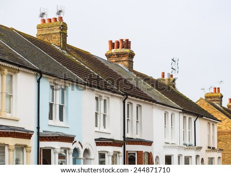 Mainly white terrace houses in a row in Kent, England. - stock photo