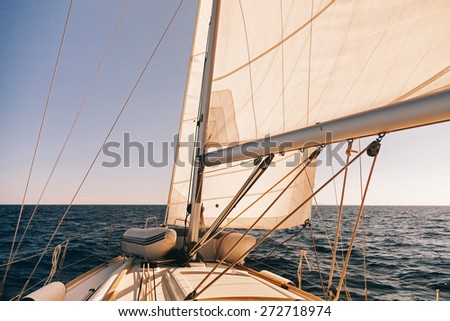Mainsheet and roller with rope of the sailing boat, instagram toning at sunset