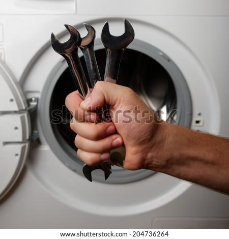 maintenance a washing machine - stock photo